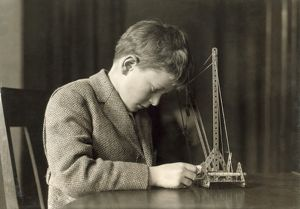 A boy playing with mechanical toy. Photograph by Lewis Hine, c1924.
