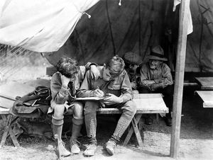 BOY SCOUTS WRITING HOME. Boy Scouts writing letters home from camp at Hunter Island