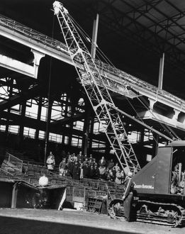 BROOKLYN: EBBETS FIELD. A crane with a wrecking ball on top of the visitors&#39