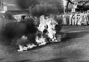 Buddhist monk Thich Quang Duc (1897-1963) committing self-immolation at an intersection in Saigon