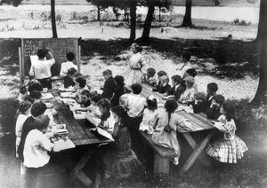 CAMP ALGONQUIN: MATH CLASS. An open-air school at Camp Algonquin with two boys