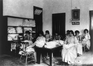 CARLISLE SCHOOL, c1901. Clothes mending class at the Carlisle Indian School in Carlisle