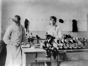 CARLISLE SCHOOL, c1904. Young Native American working on shoes at the Carlisle