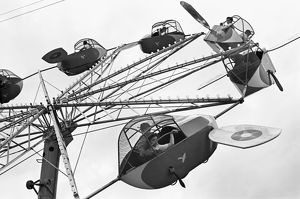 CARNIVAL RIDE, 1942. An airplane carnival ride, Brownsville, Texas. Photograph by Arthur Rothstein