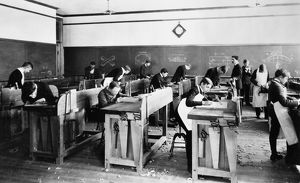CARPENTRY CLASS, 1899. Carpentry class in the manual training room at a high school