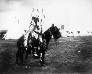 CAYUSE CHIEF, c1900. David Young, a Cayuse Native American chief, riding a horse