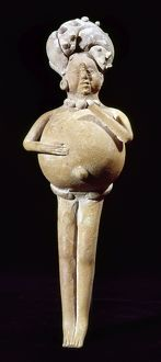 Ceramic rattle in the shape of a man, whose belly was filled with seeds. From Jaina, Campeche, Mexico, 200-900 A.D. Height: 18.5 cm.