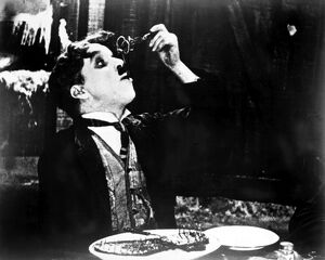 CHAPLIN: GOLD RUSH. 1925. Charlie Chaplin eating his shoe in a scene from his film 'The Gold Rush,' 1925.