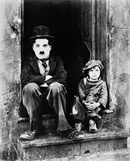 CHAPLIN: THE KID, 1921. Charlie Chaplin and Jackie Coogan as his adopted son in Chaplin's film 'The Kid,' 1921.