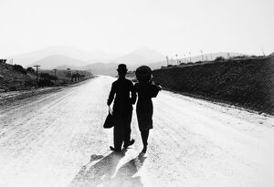 CHAPLIN: MODERN TIMES, 1936. Charlie Chaplin and Paulette Goddard in the final scene from the film