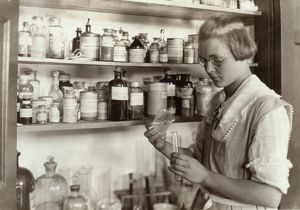 CHEMISTRY CLASS, 1921. A high school student in the chemical laboratory at the