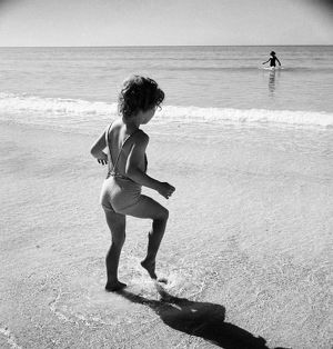 CHILD, 20th CENTURY. An unidentified child on a beach.