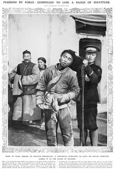 CHINA: REVOLUTION, 1912. A revolutionary soldier cuts the hair of a man, unwilling