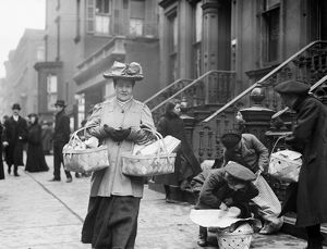 CHRISTMAS DINNER, 1908. Women carrying baskets containing Christmas dinner from the