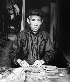 CIGAR MAKER, 1920. Portrait of Lee Ying, a Chinese cigar maker in his shop in Washington D