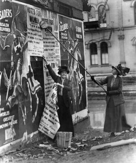 CINCINNATI: SUFFRAGETTES. Suffragettes Louise Hall and Susan Fitzgerald pasting signs