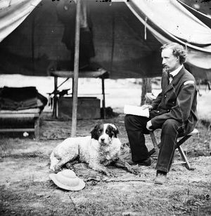 CIVIL WAR: CUSTER, 1862. Lieutenant George A. Custer with a dog at camp in Virginia, 1862.