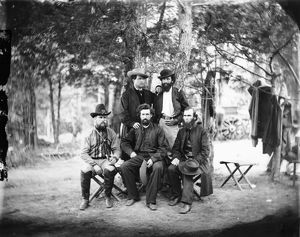 CIVIL WAR: IRISH BRIGADE. Father William Corby (seated right) and other chaplins