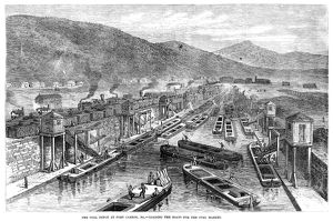COAL DEPOT, 1867. Loading boats for the coal market at the depot in Port Carbon