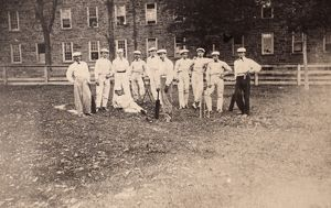 COLLEGE: STUDENTS, c1880. Student members of a cricket team on the campus of an