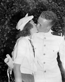 CONGRATULATIONS KISS, 1939. Walter B. Miller receiving a kiss from his girlfriend