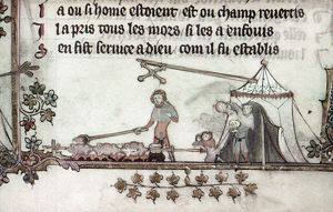 COOKS, 14th CENTURY. Cook basting birds roasting over a fire, while a man pours