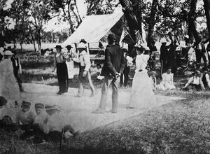 COUNTRY DANCE, 19th CENTURY. A canvas dance floor at an outdoor party in western America