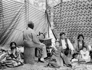 CROW FAMILY, c1906. A Crow family inside their tipi. Photograph by T.A. Morris, c1906