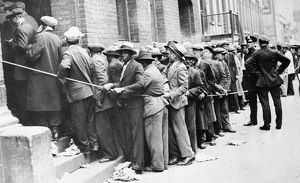DEPRESSION: HARLEM, 1931. Men lined up outside an unemployment office in Harlem, New York City