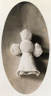 A doll made from waste material by a child in a knitting mill where mother works