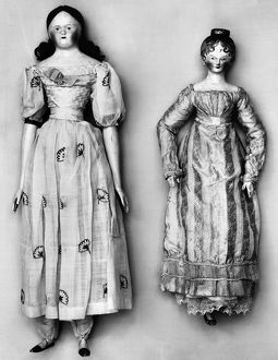 Dolls with (left) wax head, wooden hands and feet, and embroidered muslin dress with full skirt