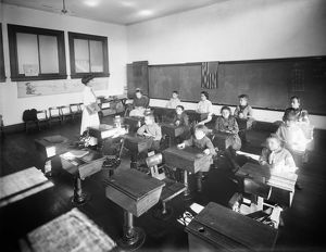 EAST SIDE FREE SCHOOL, c1910. Disabled children in a classroom at the Crippled