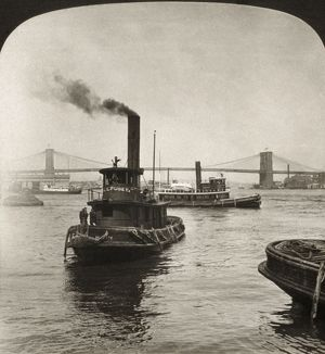 EAST RIVER, c1905. Tugboats on the East River, with the Brooklyn and Williamsburg