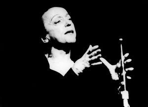 ÉDITH PIAF (1915-1963). Née Édith Giovanna Gassion. Photographed in concert
