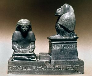EGYPT: THE GOD THOTH Thoth in the form of a baboon protecting the royal scribe Nebmertouf