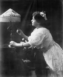 technology/electric lamp 1908 woman pulling switch electric