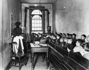 ELEMENTARY SCHOOL, c1894. A class in the condemned Essex Market School on the Lower