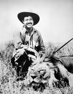 ERNEST HEMINGWAY (1899-1961). American writer. Hunting in Kenya, February 1934.