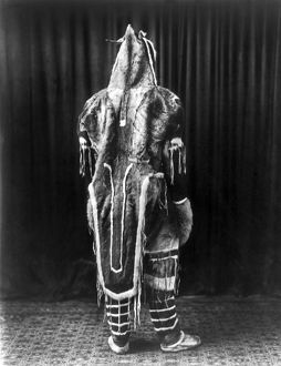 ESKIMO COSTUME, c1919. A person in a traditional Eskimo costume, seen from the rear