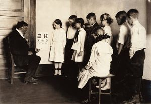 EYE EXAM, 1917. School children receiving eye exams at Washington School in Lawton