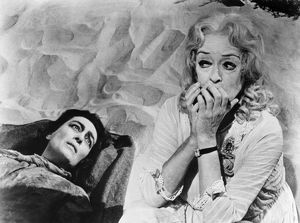 FILM: BABY JANE, 1962. Joan Crawford, left, and Bette Davis as sisters in 'What