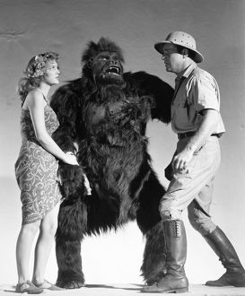 FILM STILL: NABONGA, 1944. From left to right: Julie London, Nabonga and Buster Crabbe.