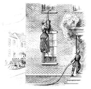 FIRE ESCAPE, 1884. A woman escaping from a burning building using a 'portable