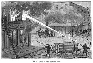 FIREFIGHTING, 1876. Demonstration of a battery for fighting fires from the street