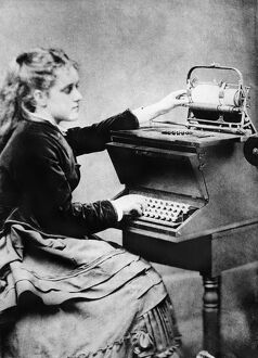 FIRST TYPIST, 1872. Lillian Sholes, 'the first typist', using a prototype