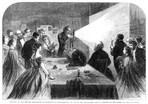 FLASH PHOTOGRAPHY, 1865. Demonstration of flash photography with a magnesium light