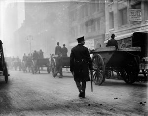 GARBAGE STRIKE, 1911. Police protecting garbage carts during a garbage strike in