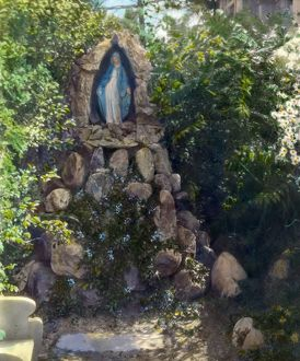 GARDEN SHRINE, 1915. A Marian shrine in a garden