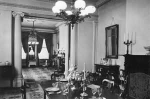 GASLIGHT CHANDELIER. Dining room and parlor at the Old Merchant's House, New York City