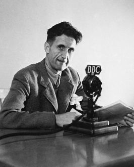 GEORGE ORWELL (1903-1950). Pseudonym of Eric Blair. English novelist and essayist. Orwell broadcasting over the BBC in London in 1943.